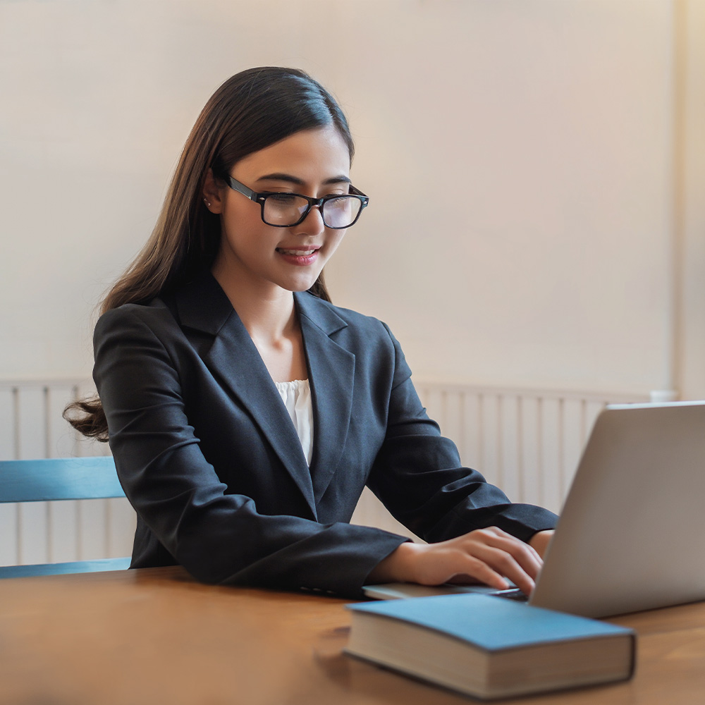 Experienced paralegal working on a laptop computer